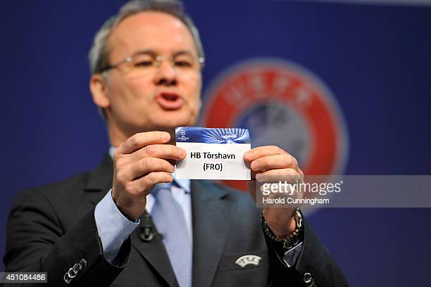 Competition Director Giorgio Marchetti shows the name HB Torshavn during to the 2014/15 UEFA Champions League 1st and 2nd Qualifying Rounds draw at...
