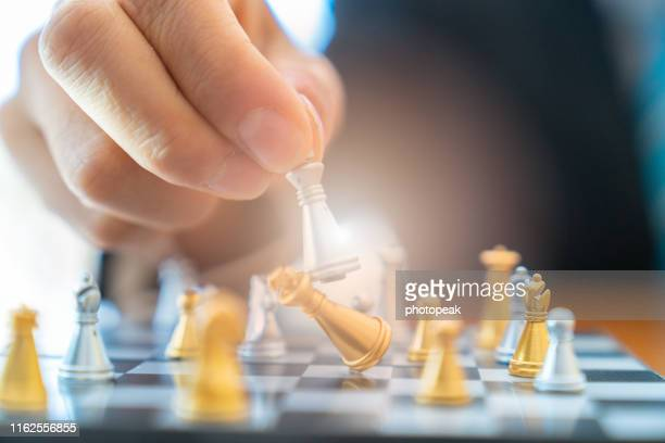 competition in chess game is a competition game in business. - stock photo - advertising column stock-fotos und bilder