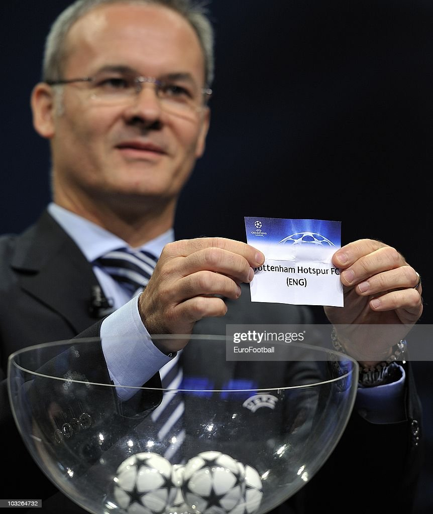 UEFA competitions director Giorgio Marchetti displays the name of Tottenham Hostpur during the UEFA Champions League play-off draw on August 6, 2010 in Nyon, Switzerland. The play-offs are played over two legs on 17/18 and 24/25 August. The ten play-off winners will join the 22 automatic entrants in the UEFA Champions League group stage, the draw for which will be held in Monaco on 26 August 26, 2010.