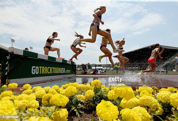 Competitiors in the Womens 3000 Meter Steeplechase clear the water barrier during day three of the 2015 USA Outdoor Track Field Championships at...