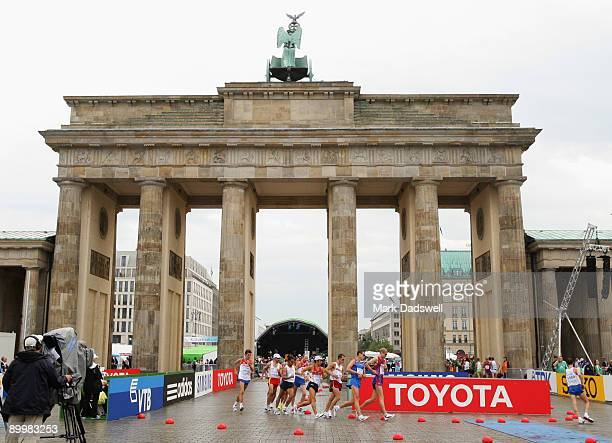 Competitiors pass around the Brandenburg Gate in the men's 50 Kilometres Race Walk Final during day seven of the 12th IAAF World Athletics...