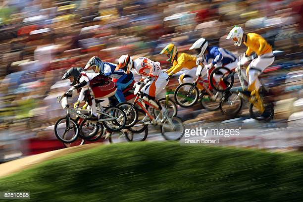 Competitiors race in the Men's BMX semifinal run held at the Laoshan Bicycle Moto Cross Venue during Day 14 of the Beijing 2008 Olympic Games on...