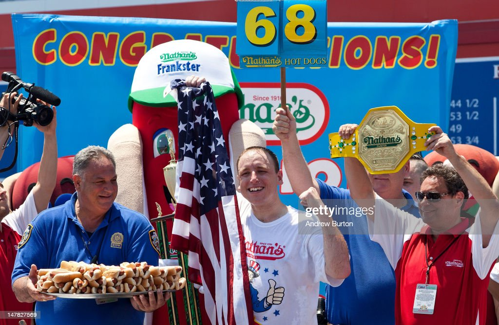 Competitive eater Joey Chestnut celebrates his victory after winning the Nathan's Famous International Hot Dog Eating Contest at Coney Island on July 4, 2012 in the Brooklyn borough of New York City. Chestnut won the men's division by successfully tying his own world record by eating 68 hot dogs in 10 minutes; he has now won the competition six years in a row.