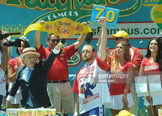 Competitive eater Joey Chestnut regains Nathan's Famous Hot Dog eating title breaks record with 70 hot dogs at the 2016 Nathans Famous 4th Of July...