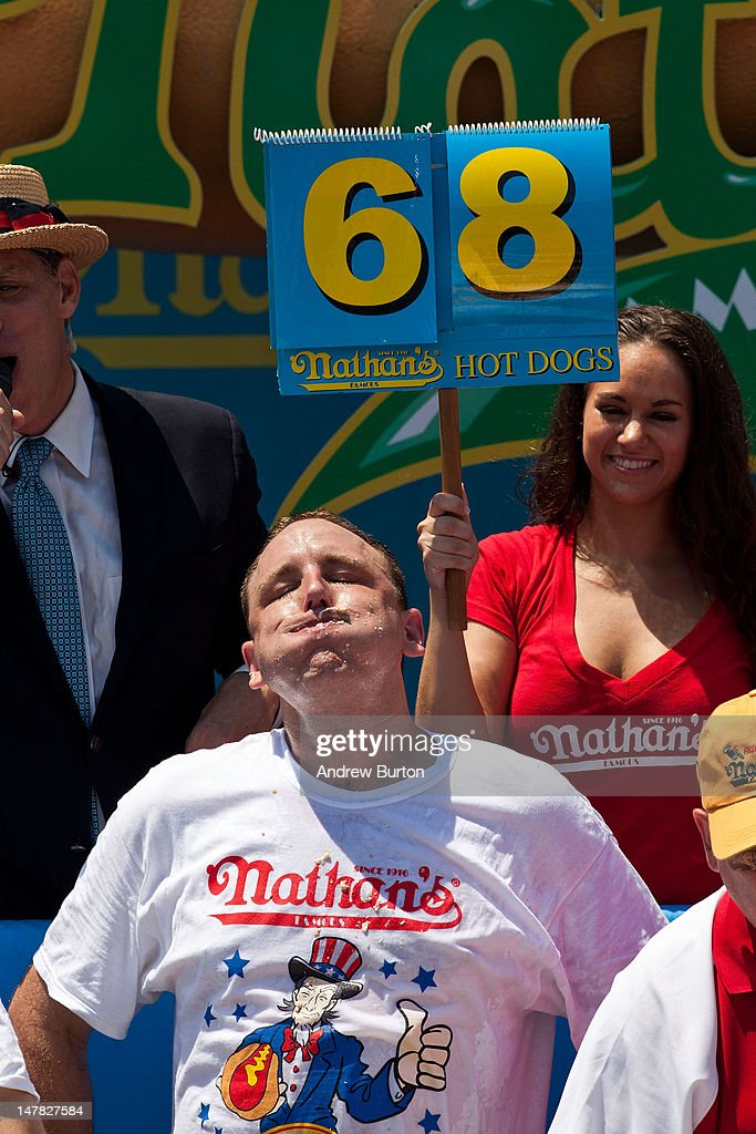 Competitive eater Joey Chestnut rests after winning the Nathan's Famous International Hot Dog Eating Contest at Coney Island on July 4, 2012 in the Brooklyn borough of New York City. Chestnut won the men's division by successfully tying his own world record by eating 68 hot dogs in 10 minutes; he has now won the competition six years in a row.