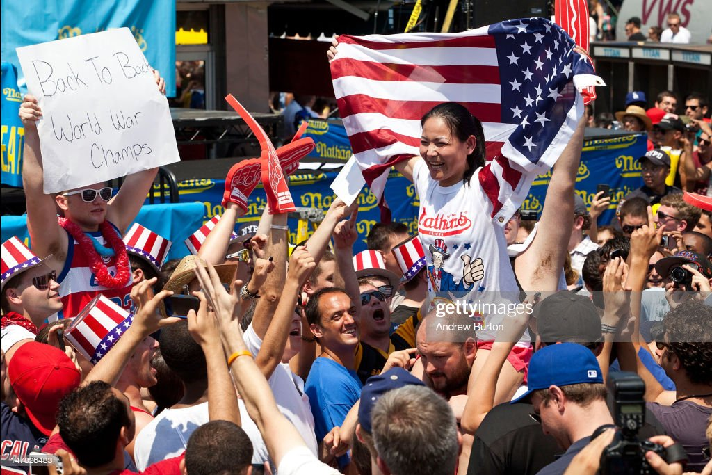 Competitive eater Sonya Thomas is carried through the crowd after winning the women's division of the Nathan's Famous International Hot Dog Eating Contest at Coney Island on July 4, 2012 in the Brooklyn borough of New York City. Thomas won the women's division by successfully eating 45 hot dogs in 10 minutes, setting a new world record.