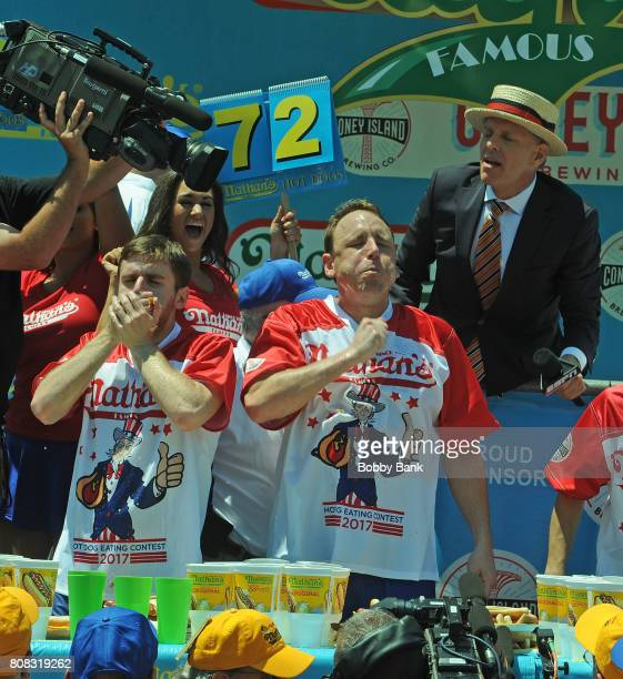 Competitive eaters Joey Chestnut and Carmen Cincotti at the 2017 Nathans Famous 4th Of July International Hot Dog Eating Contest with 72 hot dogs at...