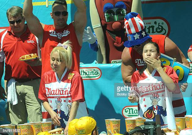Competitive eaters Miki Sudo and Sonya Thomas compete in the women's division of the 2016 Nathans Famous 4th Of July International Hot Dog Eating...