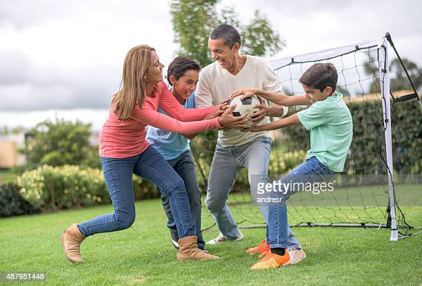 Competitive family playing football