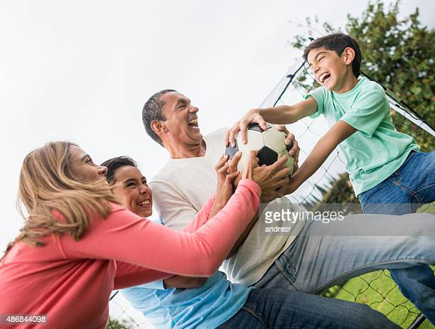 Competitive family playing soccer