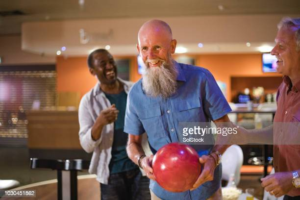 competitive seniors - bowling alley stock pictures, royalty-free photos & images