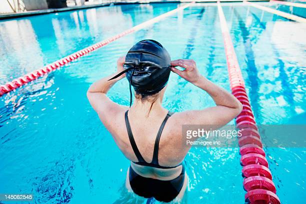 competitive swimmer in swimming pool - length stock photos and pictures
