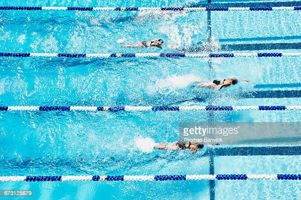 Competitive swimmers racing in outdoor pool