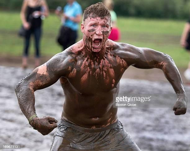 A competitor after going through the Electric Eel where dangling wires give off electronic shocks during a Tough Mudder event held at the Seneca Hunt...