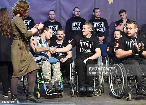 Competitor attend the awards ceremony after the 'Games of the Heroes' crossfit challenge in Kiev on December 24 2016 Some fifteen Ukrainian...