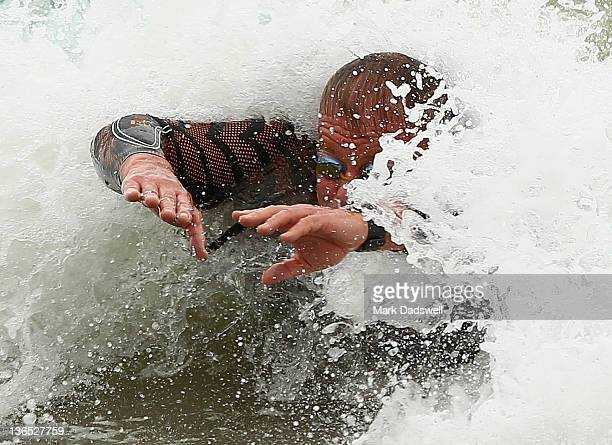 A competitor bodysurfs as he nears the beach during the 2012 Pier to Pub on January 7 2012 in Lorne Australia