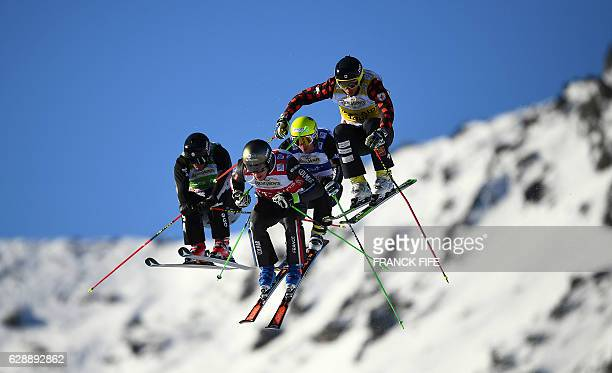 US competitor Brant Crossan France's Jean Frederic Chapuis Italy's Stefan Thanei and Canada's David Duncan compete during the FIS men's Eightfinal...