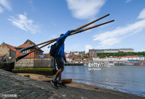 A competitor carries oars during the annual Whitby Regatta on August 10 2019 in Whitby England At over 170 years old the Whitby Regatta is thought to...