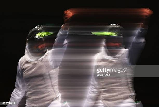 A competitor celebrates a point in the Women's Team Foil Gold Medal Match at the Fencing Hall on Day 8 of the Beijing 2008 Olympic Games on August 16...