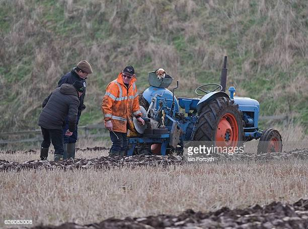 Competitor checks the straightness of his furrows during the annual ploughing match on November 27, 2016 in Staithes, United Kingdom. The event which...