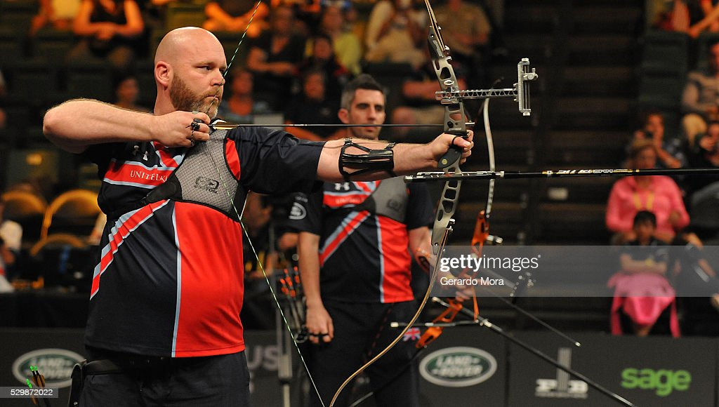 UK competitor Chris Macfayden (L), shoots during Archery Finals at the Invictus Games at ESPN Wide World of Sports complex on May 9, 2016 in Lake Buena Vista, Florida.