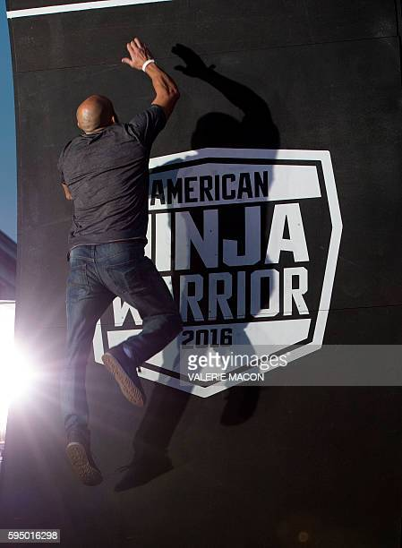 A competitor climbs the last wall of the challenge at the 'American Ninja Warrior' screening and course demonstration In celebration of the show's...