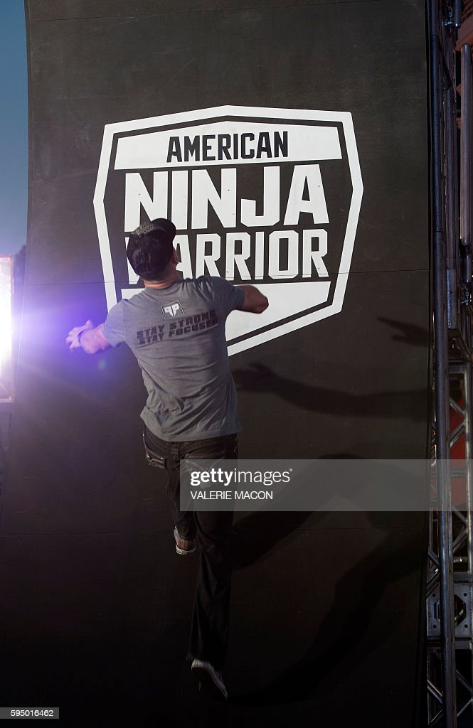A competitor climbs the last wall of the challenge at the 'American Ninja Warrior' screening and course demonstration In celebration of the show's first Emmy Award nomination, at Universal Studio, in Universal City, California, on August 24, 2016. / AFP / VALERIE