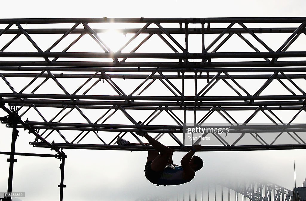 A competitor climbs the Monkey Bars in front of the Sydney Harbour Bridge during the 2012 Men's Health Urbanathlon on April 22, 2012 in Sydney, Australia.