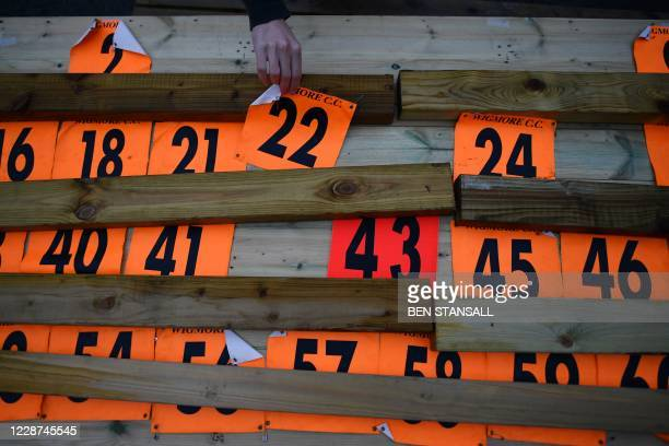 Competitor collects his number ahead of the 44th Wigmore CC Hollingbourne Hill Climb, on the north downs in south-east England on September 27 a time...