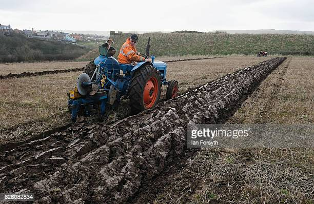 Competitor concentrates on achieving straight furrows as he takes part in the annual ploughing match on November 27, 2016 in Staithes, United...