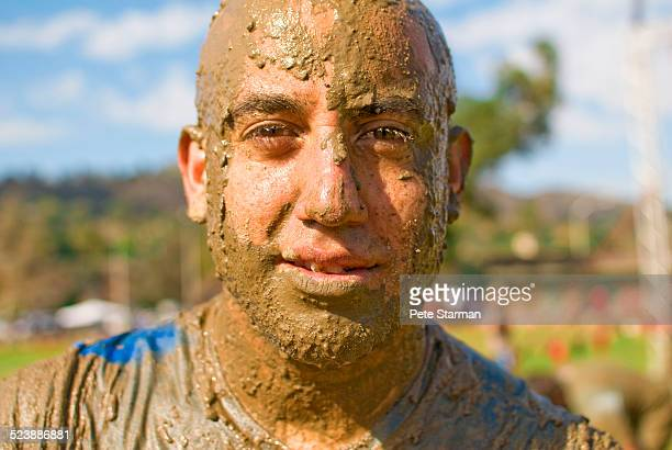 5K competitor covered in mud.