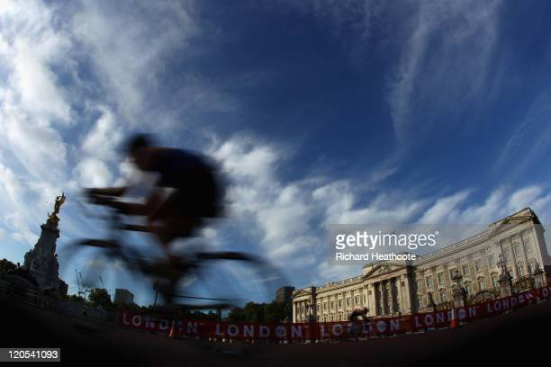 A competitor cycles past Buckingham Palace during day two of the Dextro Energy Triathlon ITU World Championship Series in Hyde Park on August 7 2011...