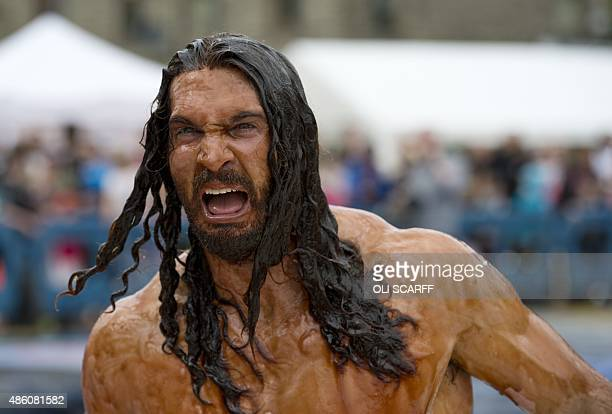 A competitor drenched in gravy takes part in the 8th annual World Gravy Wrestling Championships at the Rose n Bowl Pub in Bacup north west England on...