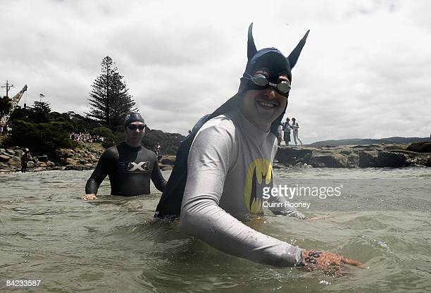 A competitor dressed as batman walks into the water ready to start the swim during the Lorne Pier To Pub open water swim at Louttit Bay January 10...