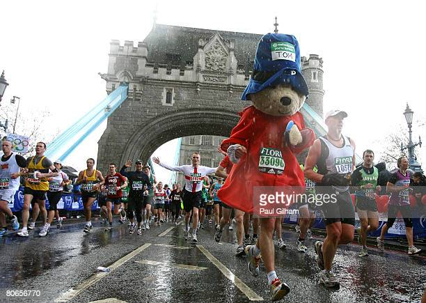 A competitor dressed as Paddington Bear runs across Tower Bridge during the 2008 Flora London Marathon on April 13 2008 in London England