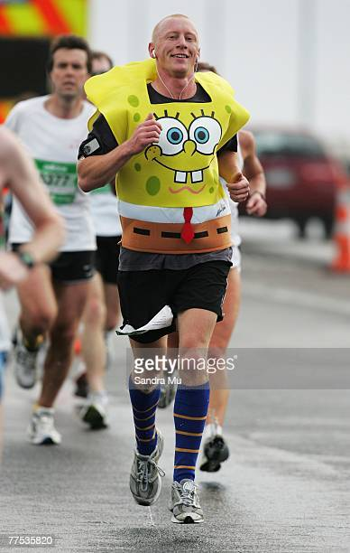 A competitor dressed as 'Sponge Bob Square Pants' runs across the Harbour Bridge during the Auckland Marathon October 28 2007 in Auckland New Zealand