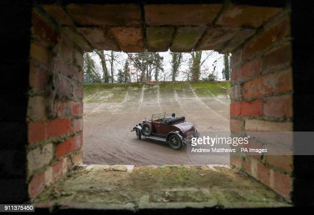 A competitor drives along a section of the old Brooklands track as they take part in the Vintage SportsCar Club annual driving test day at Brooklands...