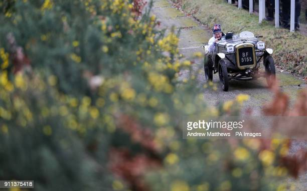 A competitor drives takes on the 'Test Hill' as they take part in the Vintage SportsCar Club annual driving test day at Brooklands Museum in Surrey