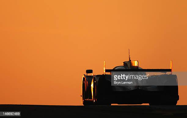 A competitor drives towards the sunrise during Le Mans 24 Hour race at the Circuit de la Sarthe on June 17 2012 in Le Mans France