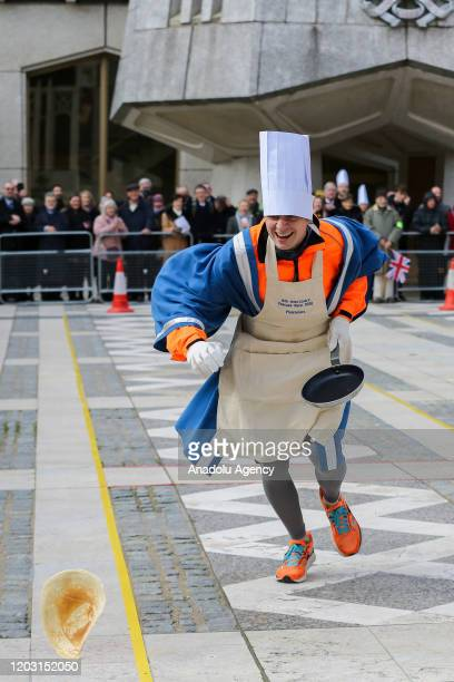 A competitor drops a pancake during the annual InterLivery Pancake Race on Shrove Tuesday at The Guildhall in London United Kingdom on February 25...