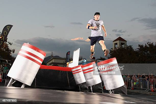 Competitor Dustin McKinney attends the NBC's 'American Ninja Warrior' season 7 finale preview screening held at The Autry National Center on...
