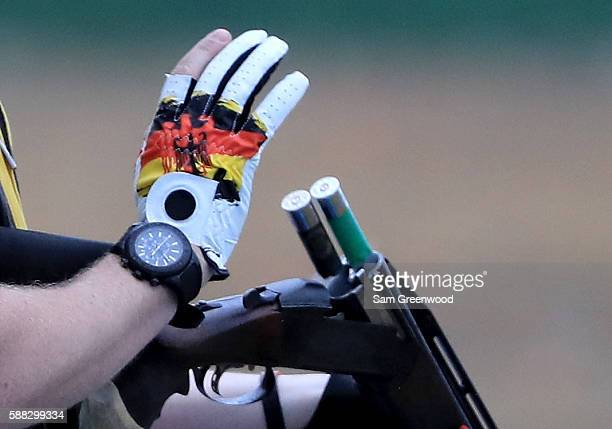 A competitor ejects shells from his shotgun on Day 5 of the Rio 2016 Olympic Games at the Olympic Shooting Centre on August 10 2016 in Rio de Janeiro...