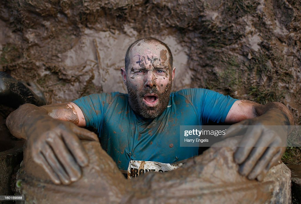 A competitor emerges from an underground tunnel during the Tough Guy Challenge on January 27, 2013 in Telford, England.