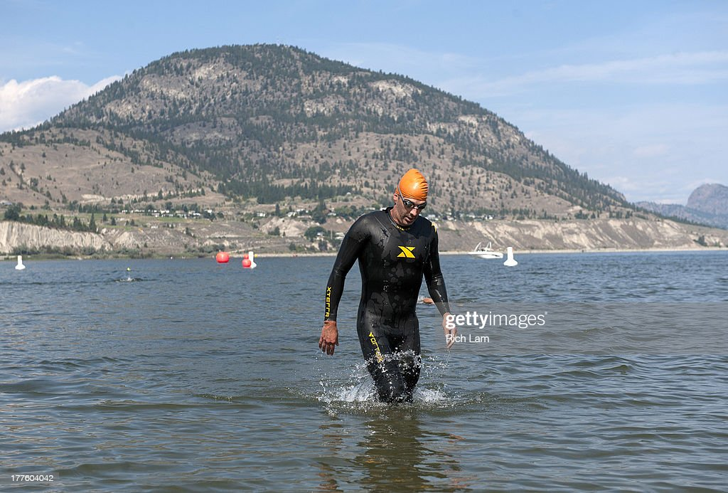 A competitor exits Okanagen Lake while practicing his swim during the Challenge Penticton Triathlon previews on August 24, 2013 in Penticton, British Columbia, Canada.
