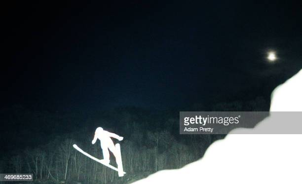 A competitor flies through the air during the first jump of the qualification round at RusSki Gorki Jumping Center on February 14 2014 in Sochi Russia
