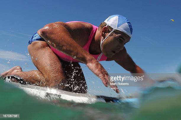 Competitor for Cudgen Headland SLSC paddles the board portion of the Open Ironman during the 2013 Australian National Surf Lifesaving Titles on April...