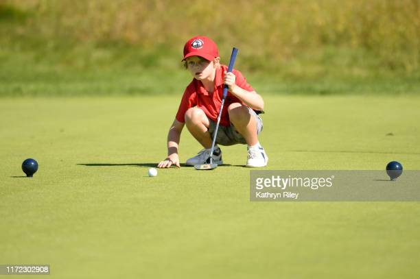 Competitor for the boys 7-9 category participates in the putting contest during the Drive, Chip, and Putt Championship at TPC River Highlands on...