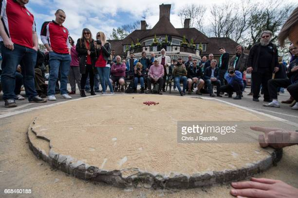 A competitor from the German '1st Murmel Club' team takes a shot at the World Marble Championships at the Greyhound pub on April 14 2017 in Crawley...