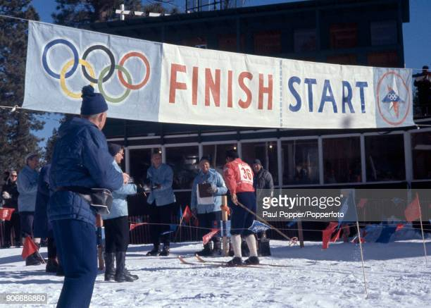 A competitor in one of the Nordic cross country skiing events crosses the finishing line during the 1960 Winter Olympic Games in Squaw Valley...