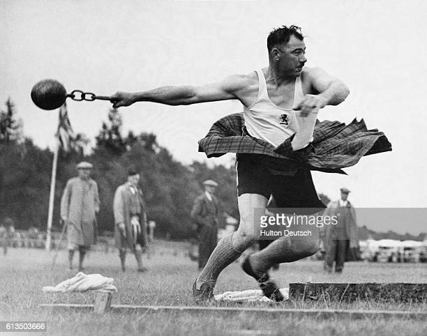 A competitor in the 64th annual Aboyne Highland Games spins around as he prepares to throw the hammer Scotland September 1935